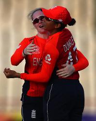 Sophia Dunkley of England is congratulated by Kirstie Gordon of England on catching Marizanne Kapp of South Africa during the ICC Women's World T20 2018 match between England and South Africa at Darren Sammy Cricket Ground on November 16, 2018.