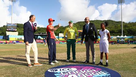 Heather Knight of England and Dane van Niekerk of South Africa pictured during the coin toss ahead of the ICC Women's World T20 2018 match between England and South Africa at Darren Sammy Cricket Ground on November 16, 2018