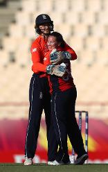 Amy Jones of England congratulates Linsey Smith of England on the wcket of Laura Wolvaardt of South Africa during the ICC Women's World T20 2018 match between England and South Africa at Darren Sammy Cricket Ground on November 16, 2018.