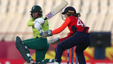 Mignon du Preez of South Africa sweeps the ball, as Amy Jones of England looks on during the ICC Women's World T20 2018 match between England and South Africa at Darren Sammy Cricket Ground on November 16, 2018 in Gros Islet, Saint Lucia.