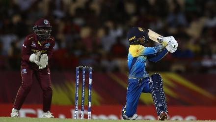 Nilakshi de Silva of Sri Lanka hits the ball towards the boundary, as Kycia Knight of Windies looks on during the ICC Women's World T20 2018 match between Windies and Sri Lanka at Darren Sammy Cricket Ground on November 16, 2018.