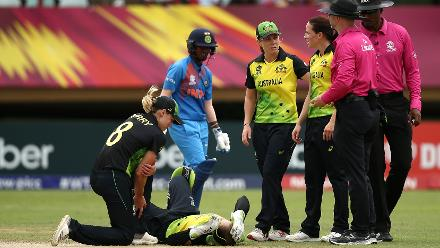 Alyssa Healy of Australia lies on the wicket injured after crashing into team mate Megan Schutt going for a catch during the ICC Women's World T20 2018 match between India and Australia at Guyana National Stadium on November 17, 2018.