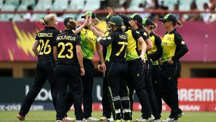 Australia players celebrate a wicket during the ICC Women's World T20 2018 match between India and Australia at Guyana National Stadium on November 17, 2018 in Providence, Guyana.