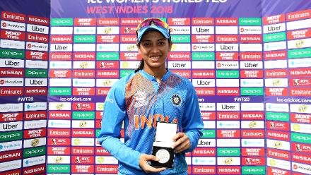 Smriti Mandhana of India poses with the player of the match during the ICC Women's World T20 2018 match between India and Australia at Guyana National Stadium on November 17, 2018 in Providence, Guyana.
