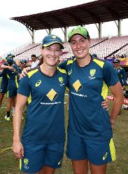 Tayla Vlaeminck of Australia receives her first cap from team mate Megan Schutt(L) during the ICC Women's World T20 2018 match between India and Australia at Guyana National Stadium on November 17, 2018 in Providence, Guyana.