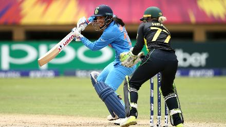 Smriti Mandhana of India bats with Alyssa Healy of Australia looking on during the ICC Women's World T20 2018 match between India and Australia at Guyana National Stadium on November 17, 2018 in Providence, Guyana.