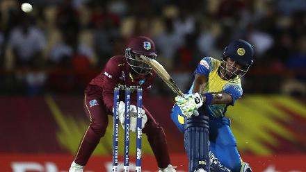 Charmari Athapaththu of Sri Lanka hits the ball towards the boundary, as Kycia Knight of Windies looks on during the ICC Women's World T20 2018 match between Windies and Sri Lanka at Darren Sammy Cricket Ground on November 16, 2018.
