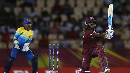Hayley Matthews of Windies hits the ball towards the boundary, as Dilani Manodara of Sri Lanka looks on during the ICC Women's World T20 2018 match between Windies and Sri Lanka at Darren Sammy Cricket Ground on November 16, 2018