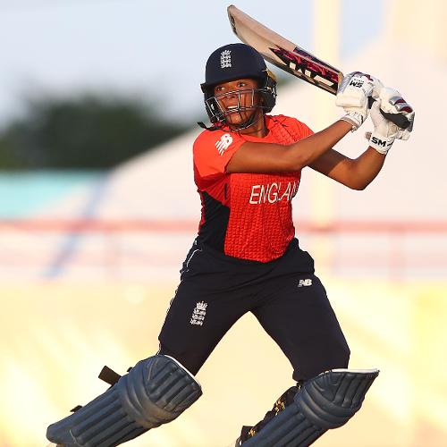 Sophia Dunkley of England hits the ball towards the boundary during the ICC Women's World T20 2018 match between Windies and England at Darren Sammy Cricket Ground on November 18, 2018 in Gros Islet, Saint Lucia.