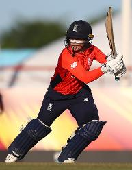 Tammy Beaumont of England hits the ball towards the boundary during the ICC Women's World T20 2018 match between Windies and England at Darren Sammy Cricket Ground on November 18, 2018 in Gros Islet, Saint Lucia.