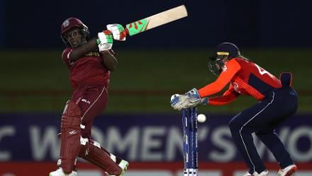 Deandra Dottin of WiIndies pulls the ball towards the boundary, asAmy Jones of England looks on during the ICC Women's World T20 2018 match between Windies and England at Darren Sammy Cricket Ground on November 18, 2018 in Gros Islet, Saint Lucia.