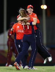 Heather Knight of England congratulates Sophie Ecclestone of England on bowling Natasha McLean of Windies during the ICC Women's World T20 2018 match between Windies and England at Darren Sammy Cricket Ground on November 18, 2018.