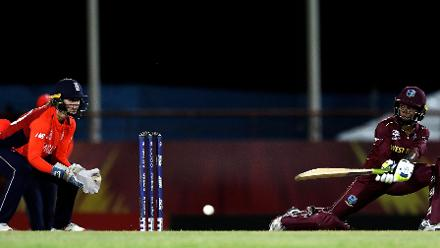Shemaine Campbelle of Windies sweeps the ball towards the boundary, as Amy Jones of England looks on during the ICC Women's World T20 2018 match between Windies and England at Darren Sammy Cricket Ground on November 18, 2018.