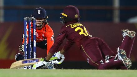 Amy Jones of England looks to run out Shemaine Campbelle of Windies during the ICC Women's World T20 2018 match between Windies and England at Darren Sammy Cricket Ground on November 18, 2018 in Gros Islet, Saint Lucia.