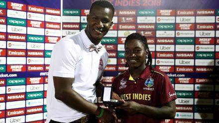 Daren Sammy presents Deandra Dottin of Windies with the 'Player of the Match' award after the ICC Women's World T20 2018 match between Windies and England at Darren Sammy Cricket Ground on November 18, 2018 in Gros Islet, Saint Lucia.