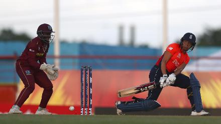 Sophia Dunkley of England sweeps the ball, Kycia Knight of Windies looks on during the ICC Women's World T20 2018 match between Windies and England at Darren Sammy Cricket Ground on November 18, 2018 in Gros Islet, Saint Lucia.