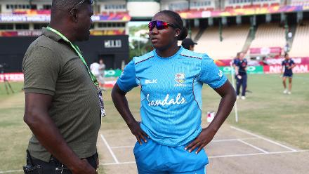 Stafanie Taylor of Windies talks to groundsman Kent Crafton during the ICC Women's World T20 2018 match between Windies and England at Darren Sammy Cricket Ground on November 18, 2018 in Gros Islet, Saint Lucia.