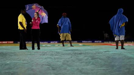 Groundsman Kent Crafton and reserve umpire Kim Cotton look on, as rain delays the start of the ICC Women's World T20 2018 match between South Africa and Bangladesh at Darren Sammy Cricket Ground on November 18, 2018 in Gros Islet, Saint Lucia.