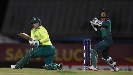 Lizelle Lee of South Africa sweeps the ball towards the bounadry, as Nigar Sultana of Bangladesh looks on during the ICC Women's World T20 2018 match between South Africa and Bangladesh at Darren Sammy Cricket Ground on November 18, 2018.