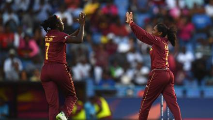 Stafanie Taylor (L) and Afy Fletcher of the Windies celebrate the wicket of Alyssa Healy of Australia during the ICC Women's World T20 2018 Semi-Final match between Windies and Australia at Sir Viv Richards Cricket Ground on November 22, 2018 in Antigua.