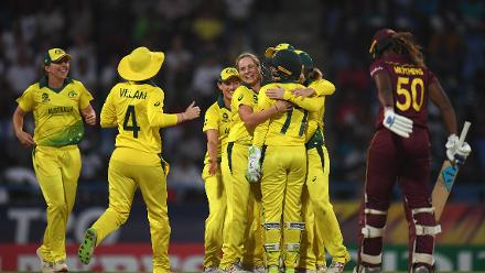 The Australia side celebrate as Alyssa Healy of Australia (back) stumps Hayley Matthews of the West Indies(R) during the ICC Women's World T20 2018 Semi-Final match between West Indies and Australia at Sir Viv Richards Cricket Ground on November 22, 2018.