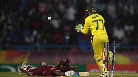 Hayley Matthews of Windies (floor) cuts a dejected figure as she looks towards the umpire after being stumped by Alyssa Healy of Australia(R) during the ICC Women's World T20 2018 Semi-Final match between Windies and Australia.