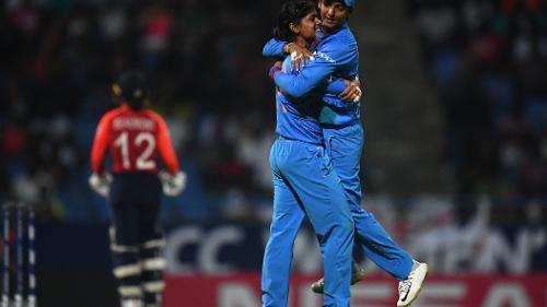 Radha Yadav and Harmanpreet Kaur of India celebrate the wicket of Tammy Beaumont of England during the ICC Women's World T20 2018 Semi-Final match between England and India at Sir Viv Richards Cricket Ground on November 22, 2018 in Antigua.