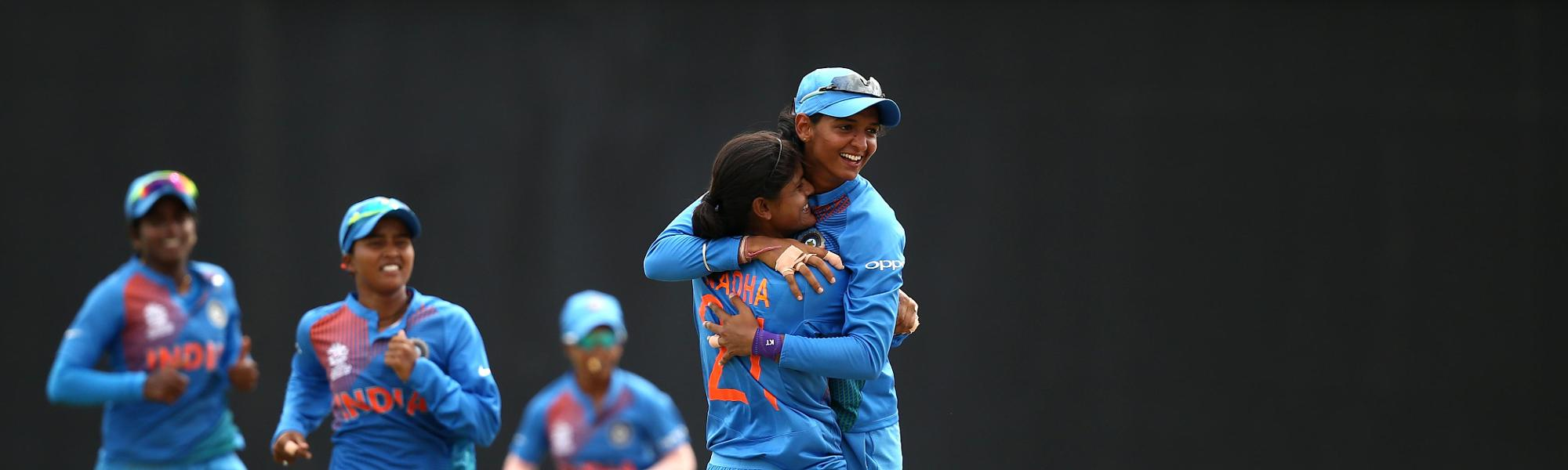 Radha Yadav of India celebrates a wicket with captain Harmanpreet Kaur during the ICC Women's World T20 2018 match between India and Australia at Guyana National Stadium on November 17, 2018 in Providence, Guyana.