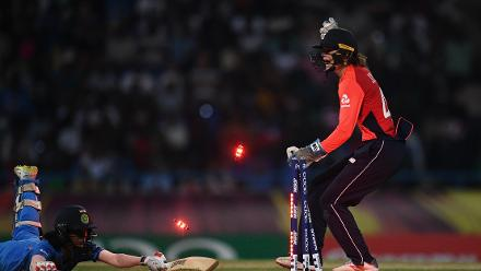 Amy Jones of England(R) reacts as she runs out Jemimah Rodrigues of India during the ICC Women's World T20 2018 Semi-Final match between England and India at Sir Viv Richards Cricket Ground on November 22, 2018 in Antigua, Antigua and Barbuda.