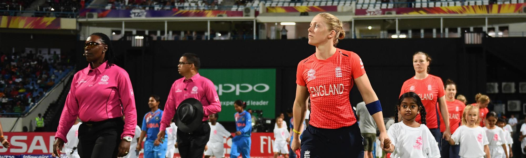 Heather Knight of England leads out her side for the national anthems during the ICC Women's World T20 2018 Semi-Final match between England and India at Sir Viv Richards Cricket Ground on November 22, 2018 in Antigua, Antigua and Barbuda.