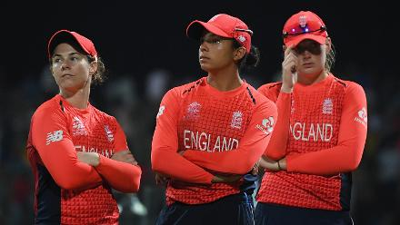 Tammy Beaumont, Sophia Dukley and Sophie Ecclestone of England cut dejected figures after the match during the ICC Women's World T20 2018 Final between Australia and England at Sir Vivian Richards Cricket Ground on November 24, 2018 in Antigua.