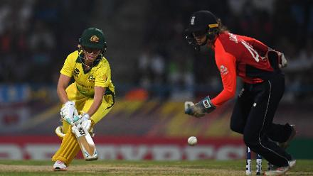 Beth Mooney of Australia attempts to make her ground during the ICC Women's World T20 2018 Final between Australia and England at Sir Vivian Richards Cricket Ground on November 24, 2018 in Antigua, Antigua and Barbuda.