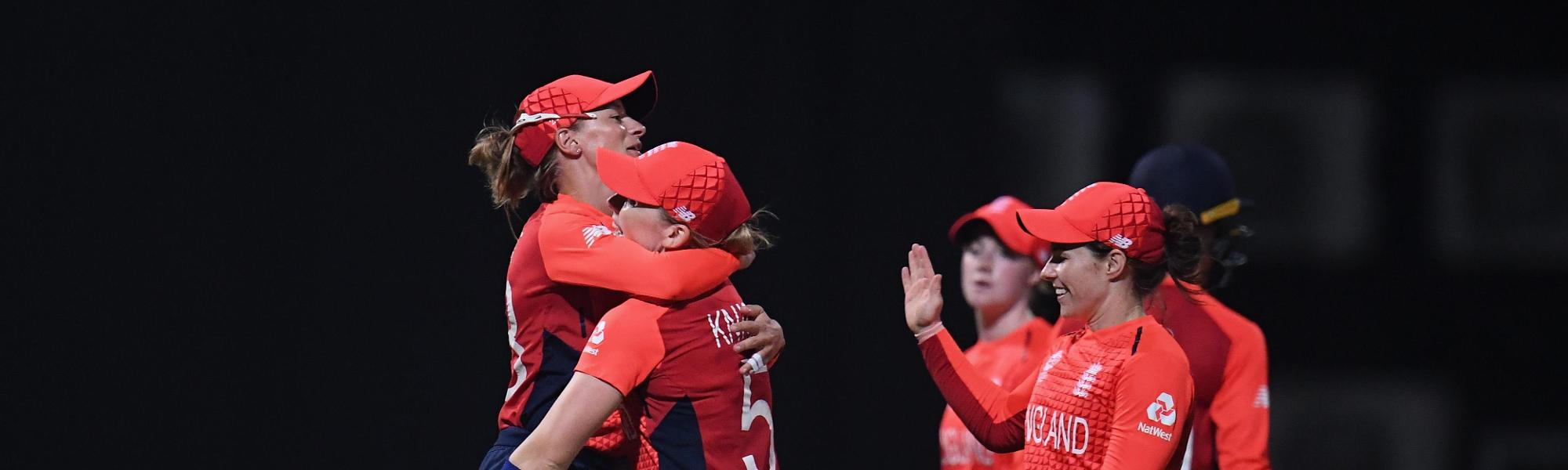 Danielle Wyatt of England(L) celebrates as she runs out Radha Yadav of India during the ICC Women's World T20 2018 Semi-Final match between England and India at Sir Viv Richards Cricket Ground on November 22, 2018 in Antigua, Antigua and Barbuda.