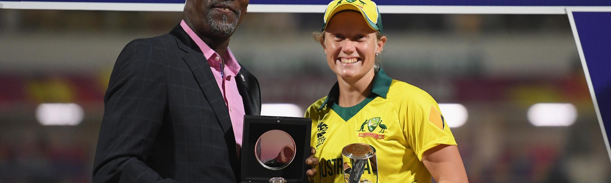Alyssa Healy of Australia is presented with the Player of the Tournament award by Sir Viv Richards.
