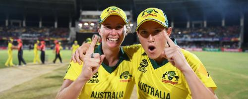 Beth Mooney and Megan Schutt of Australia celebrate during the ICC Women's World T20 2018 Final between Australia and England at Sir Vivian Richards Cricket Ground on November 24, 2018 in Antigua, Antigua and Barbuda.
