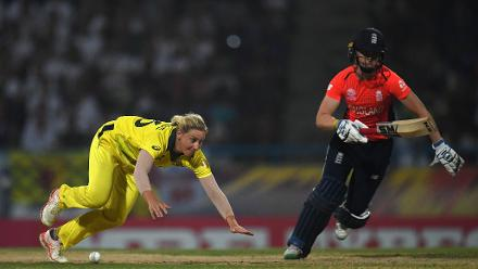 Delissa Kimmince of Australia slips as she attempts to run out Heather Knight of England during the ICC Women's World T20 2018 Final between Australia and England at Sir Vivian Richards Cricket Ground on November 24, 2018 in Antigua, Antigua and Barbuda.