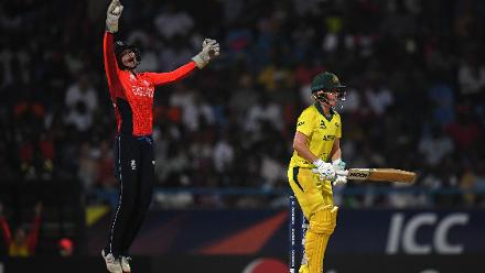 Amy Jones of England(L) celebrates after catching Beth Mooney of Australia during the ICC Women's World T20 2018 Final between Australia and England at Sir Vivian Richards Cricket Ground on November 24, 2018 in Antigua, Antigua and Barbuda.