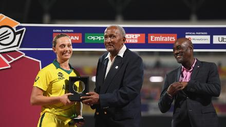 Ashleigh Gardner of Australia is presented with the Player of the Match award by Sir Andy Roberts.