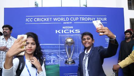 Students in Bangalore take selfies with the ICC Cricket World Cup 2019 trophy