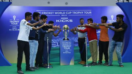 Fans pose with the ICC Cricket World Cup 2019 trophy in Bangalore
