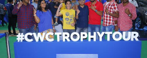 Fans in Bangalore pose with the ICC Cricket World Cup 2019 trophy