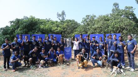 Fans – both human and canine – with the ICC Cricket World Cup 2019 trophy at the Rajarajeshwari College of Engineering
