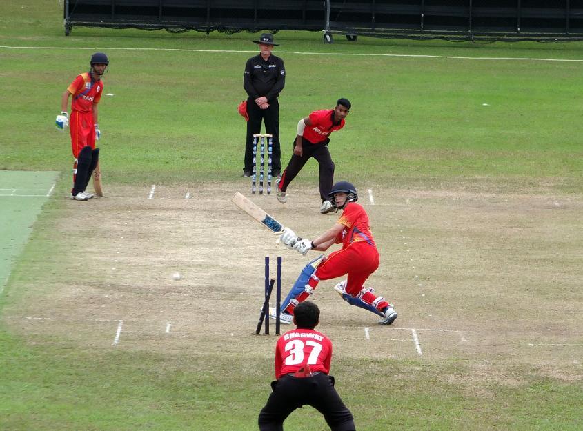A Bahrain batsman is bowled attempting a scoop