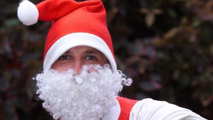 England's Graeme Swann poses as Santa Claus