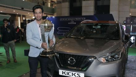 Unmukt Chand poses with the ICC CWC Trophy with the Nissan Kicks in the background