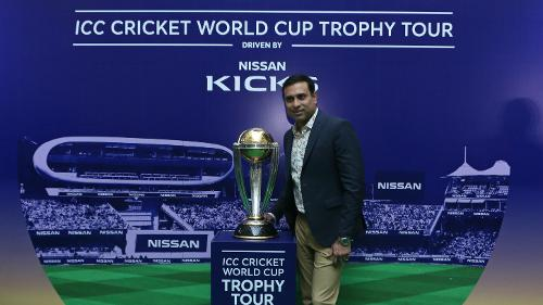 VVS Laxman poses with the World Cup trophy during the ICC CWC Trophy Tour driven by Nissan Kicks