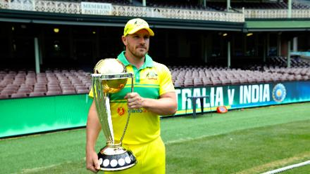 Aaron Finch poses with the ICC Cricket World Cup Trophy