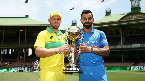 Virat Kohli and Aaron Finch pose with the ICC Cricket World Cup Trophy at the Sydney Cricket Ground