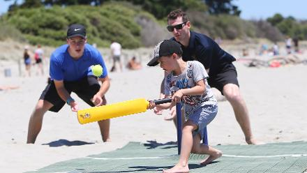 Kids play beach cricket at the Tahunanui beach in Nelson during the ICC CWC Trophy Tour driven by Nissan
