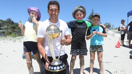 Ross Taylor and young cricket fans pose with the ICC Cricket World Cup Trophy in Nelson